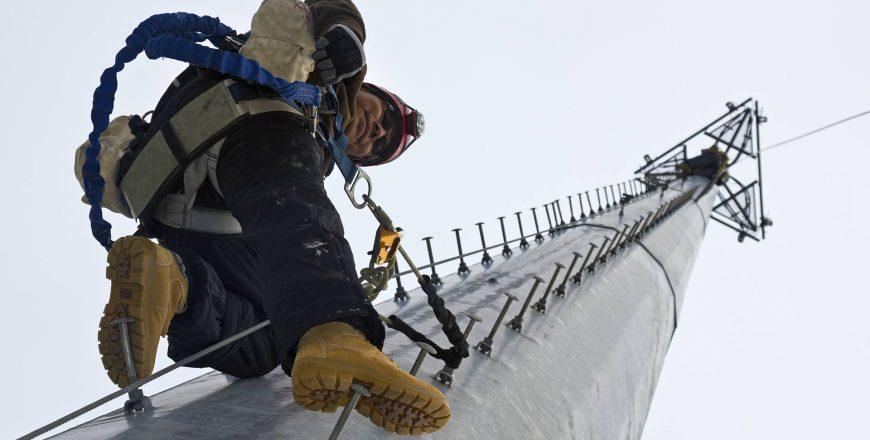 Cell Tower Technician Climbing Pole