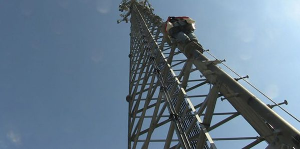 Student Climbing Tower